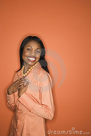 African-American woman wearing orange clothing.