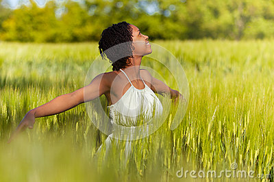 African American woman in a wheat field