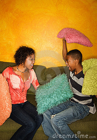 African-Americans having pillow fight
