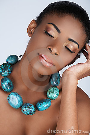 African beauty in necklace