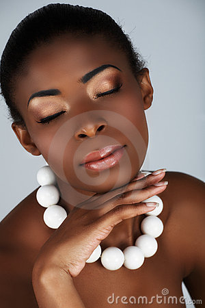 African beauty with white corals