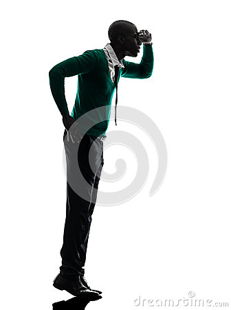 African black man standing tiptoe looking away silhouette