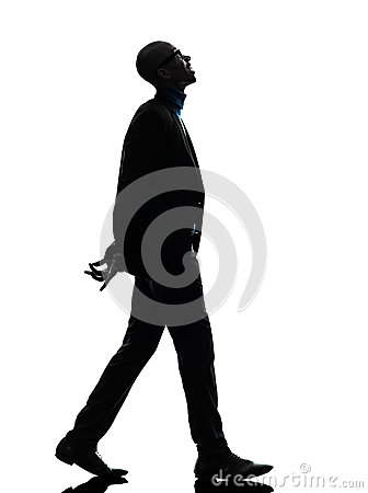 African black man walking looking up smiling silhouette