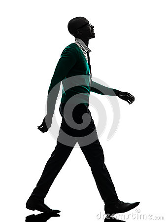 African black man walking looking up smiling silhouette silhouet