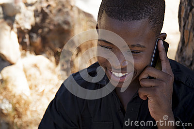 African boy on cell phone