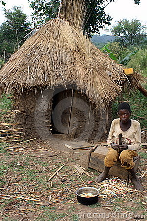 African Boy and Mud Hut Editorial Stock Image
