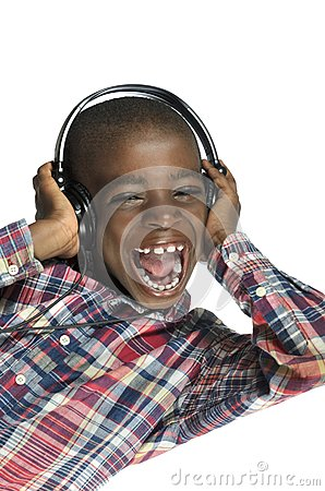Free African Boy With Headphones Listening To Music Stock Photography - 35873262