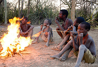 African bushmen by the fire Editorial Image