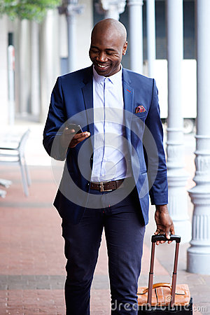 Free African Business Man Traveling With Bag And Cell Phone Royalty Free Stock Photos - 65927168