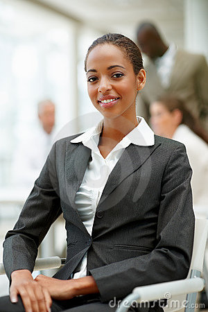 An African business woman sitting in the office