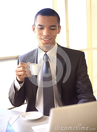 African businessman having coffee break