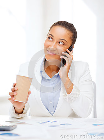 African businesswoman with smartphone in office