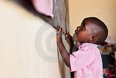 african Child at  blackboard Editorial Image