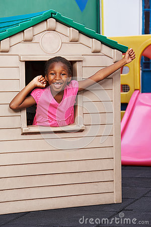 Free African Child Cheering In Playhouse Stock Photography - 74144462