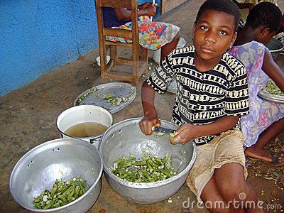 African child cooking Editorial Stock Photo