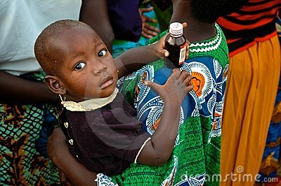 African Child Holding Medicine Editorial Image