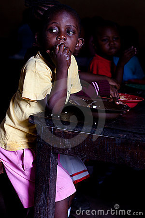 African child in school lunch Editorial Photography