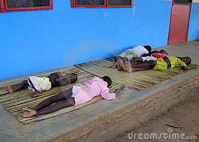 African Children Sleeping On The Floor Editorial Image