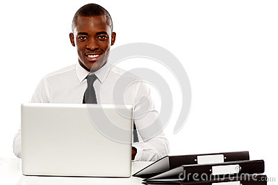 African corporate male manager at work desk