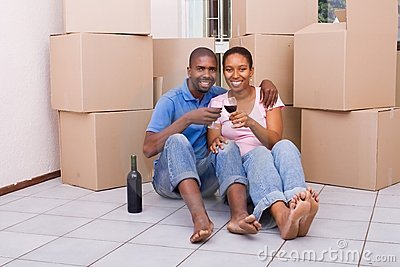 African couple celebrating new home