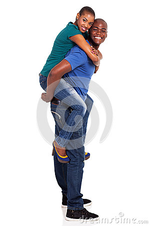 African couple piggyback