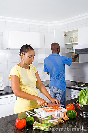 African couple preparing food