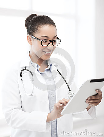 African doctor with tablet pc