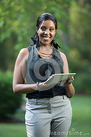 African Female Holding a Touch Pad Tablet PC