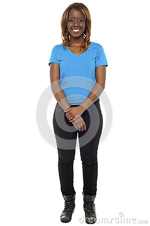 African girl posing in casuals and wearing boots