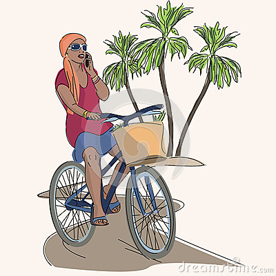 African girl riding bicycle and talking a phone
