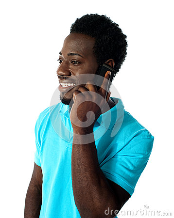 African guy communicating via cellphone