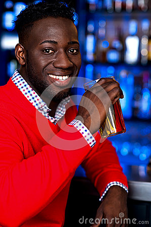 African guy drinking chilled beer
