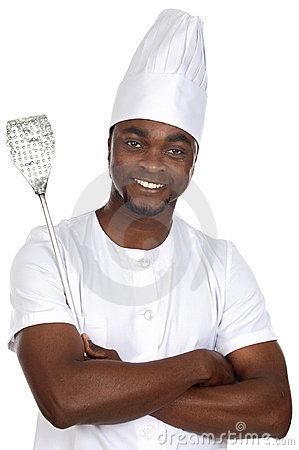 African handsome cook with kitchen utensils