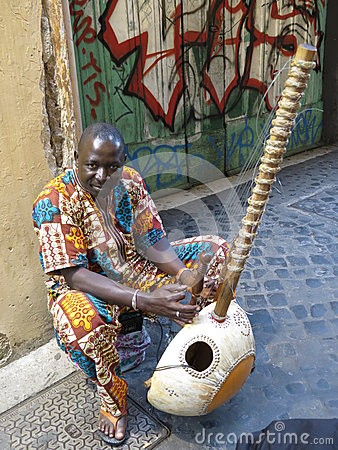 African harp player Editorial Photo