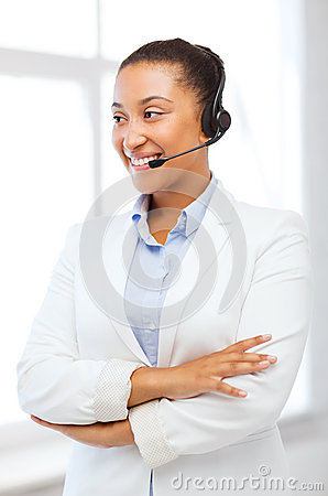 African helpline operator with headphones