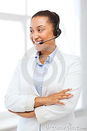 African helpline operator with headphones