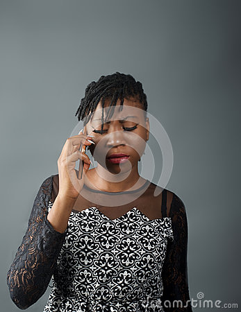 Free African Lady Looking Pensive Whilst On A Call Stock Photography - 91927172