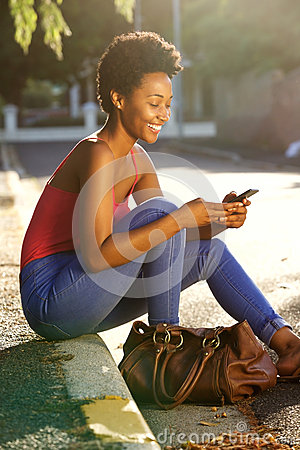 Free African Lady Woman Using Mobile Phone Royalty Free Stock Photo - 66627905