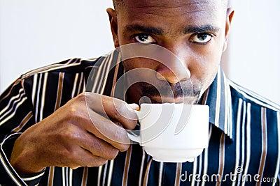 African man drinking coffee