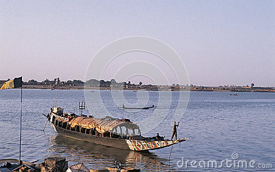 African man pinnace navigating the river Niger Editorial Stock Image