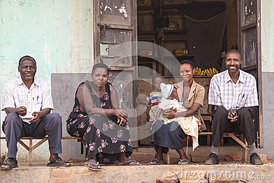 African people sitting in front of the house Editorial Image