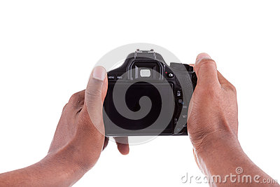 African photographer holding a digital camera