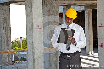 African site inspector surveying construction site