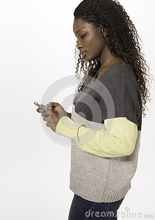 African teen texting on a smartphone