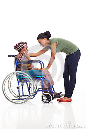 African woman comforting disabled grandmother