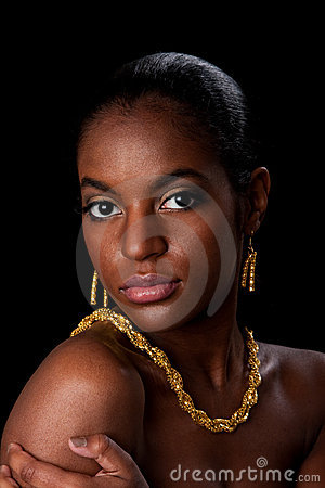 African woman face with gold jewelry