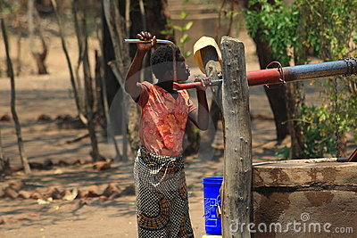 African woman fetching water Editorial Image