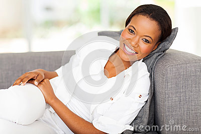African woman lying couch
