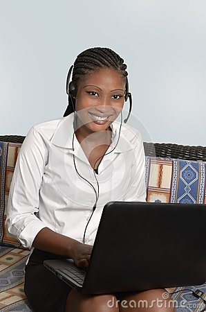 African woman with notebook and headset