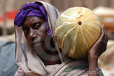 African woman with pumpkin Editorial Stock Photo
